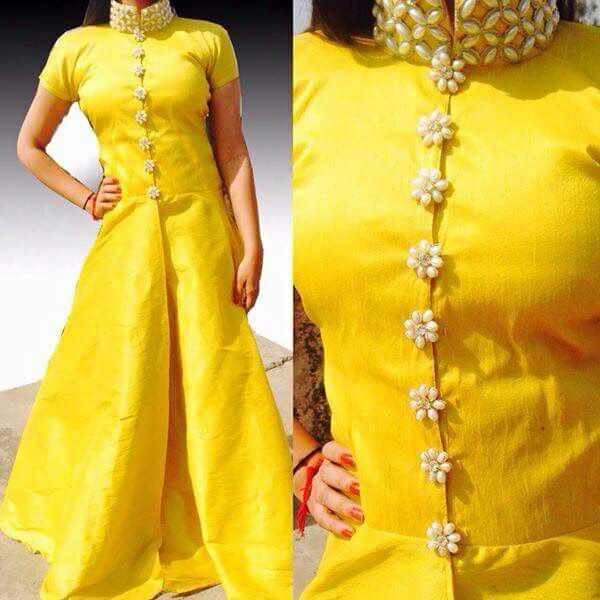 Yellow high neck Kurti get the suits designed @nivetas Design Studio visit us at www.facebook.com/punjabisboutique whatsapp +917696747289