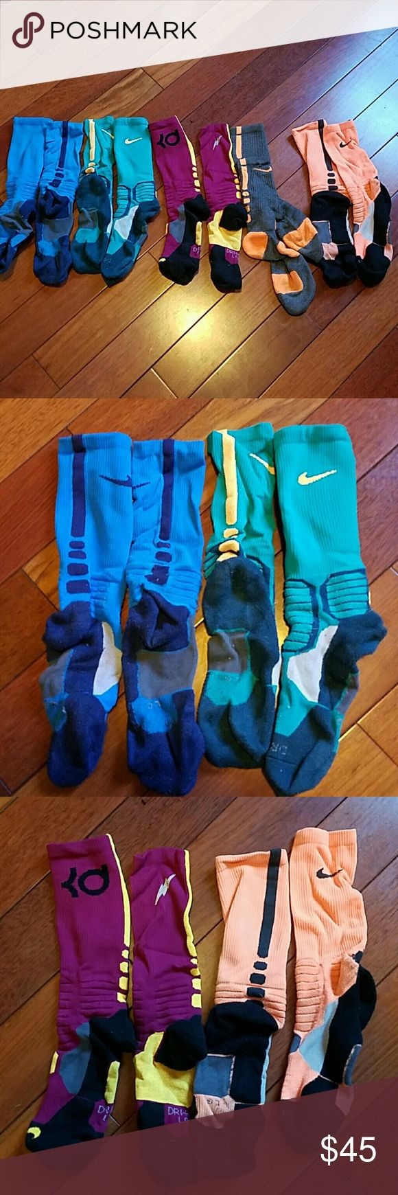 Nike Elite socks bundle Nike Elite socks bundle  5 pairs Blue on blue  sz L Teal and yellowish orange - sz L KD socks - sz L Orange and black - sz L Orange and gray - L  All in really good condition! Nike  Underwear & Socks