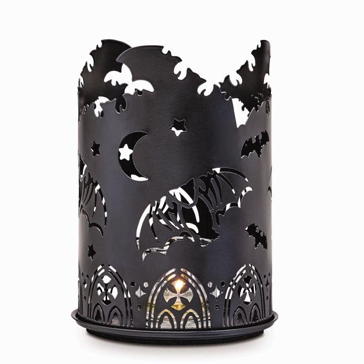 Aavemaiset varjot -somiste Kynttiläpurkille  p92502   Metalliholkki ja alusta. Korkeus 18 cm. (Kynttiläpurkki, Pilarikynttilä)