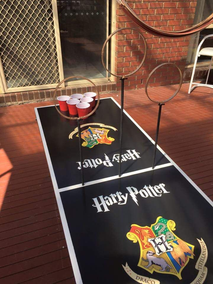 This game is definitely going to be the most liked activity by your guests. The rules remain the same as that of the beer pong. To make the game more Harry Potter-ish, make three rings on three stands as shown below and place them between the two cup-sets and the person should goal by passing the ball through the stands.