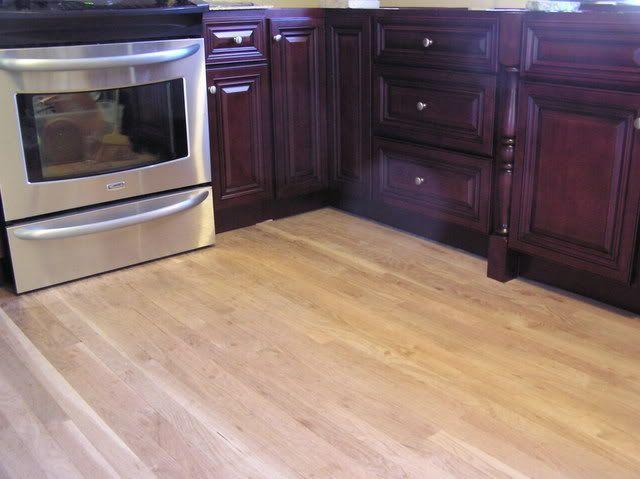 Light floor dark cabinets kitchens scandinavian style for Kitchen with dark cabinets and dark floors