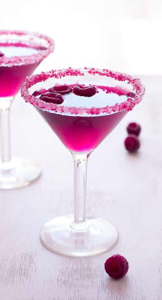 Raspberry Cosmo !! 1.25 oz Smirnoff Raspberry 0.25 fl oz Orange Liqueur 1.5 fl oz Pomegranate Juice 0.25 fl oz Lime Juice Combine all the ingredients in an ice filled shaker + Shake well +Strain into a well chilled martini glass + Garnish with a raspberry.