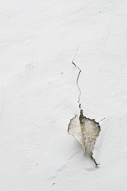 Paint peeling off of pension walls.