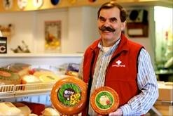 Nose knows when you're visiting stinky cheese capital. Owner Tony Zgraggen at the Alp and Dell artisanal cheese store in Monroe, Wis., shows off some stinky cheese. The store is one of the few places in the area where Limburger cheese, famous for its smell, can be bought.
