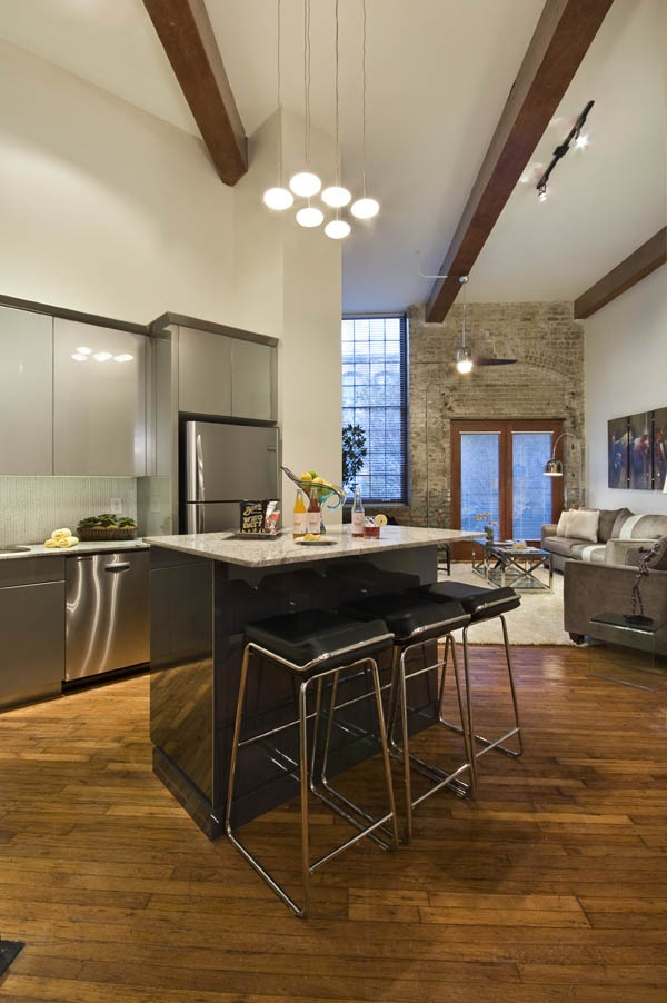 Original hardwood floors and brick walls (with modern stainless steel appliances) are just two beautiful focal points in our luxurious condos. Looking for a gorgeous space to lease in New Orleans? http://nolaluxuryleases.com