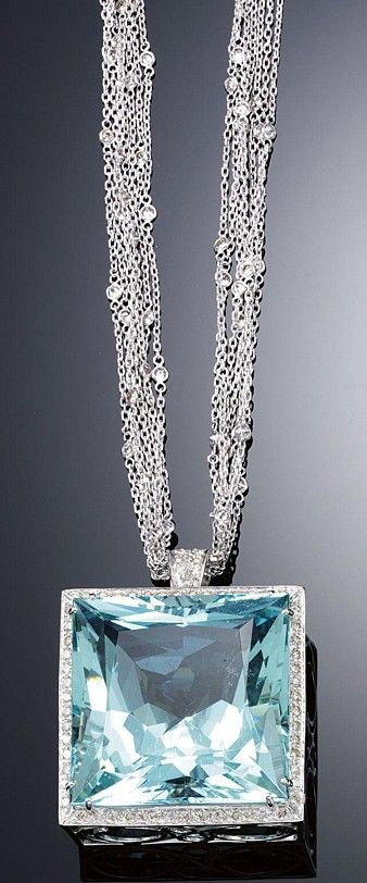 The square mixed-cut aquamarine pendant embellished with a line of brilliant-cut diamonds to a surmount similarly-set, on a necklace composed of fine chains spectacle-set at intervals with brilliant-cut stones, length approximately 435mm. - Style Estate -