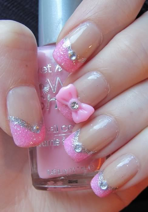 Pretty pink nail design with glitter, rhinestones, and a pretty pink bow.