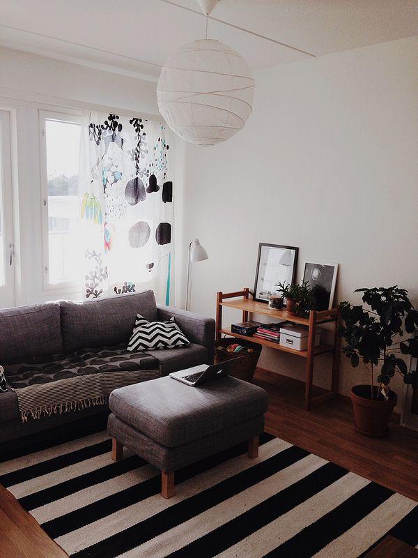Living room, Marimekko curtains, House of Rym blanket, Lundia shelves, Ikea Karlstad sofa