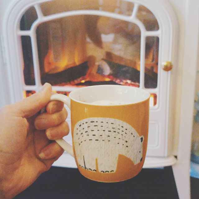 Chai latté in front of the fire with my new bear mug from Geoge at Asda. Their A/W homeware is amazing, blog post to follow later! I feel really cosy, nothing like being tucked up warm inside when it's lashing down with rain outside. Autumn is definitely here! {#autumn #fire #cosy #winter #chailatte #rainyday}