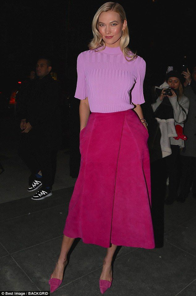 5bb06532393fb Karlie Kloss radiated retro elegance in a tight orchid-colored sweater and  suede pink skirt during was Carolina Herrera s NYFW show Monday