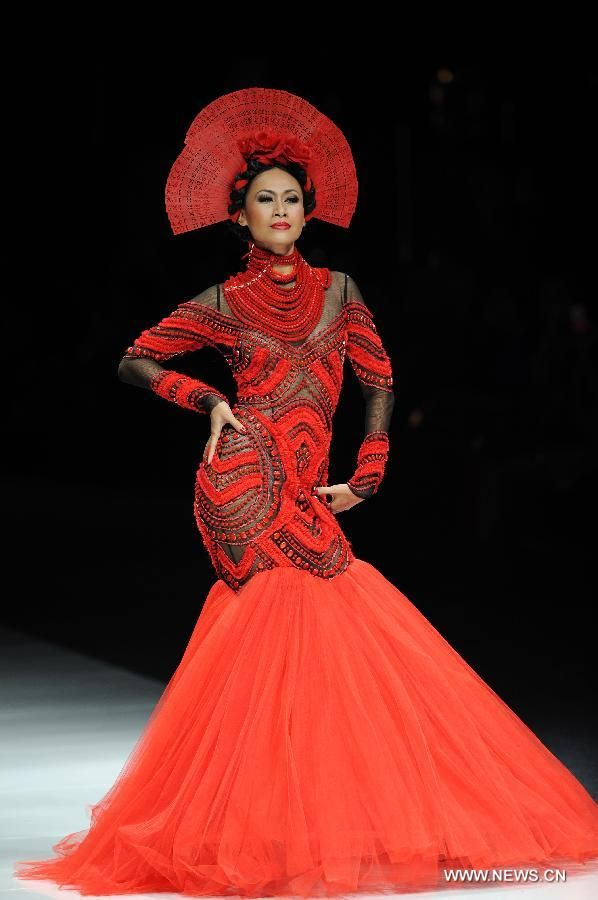 A model presents a creation by designer Denny Wirawan during the Jakarta Fashion Week 2013 in Jakarta, capital of Indonesia, Nov. 9, 2012