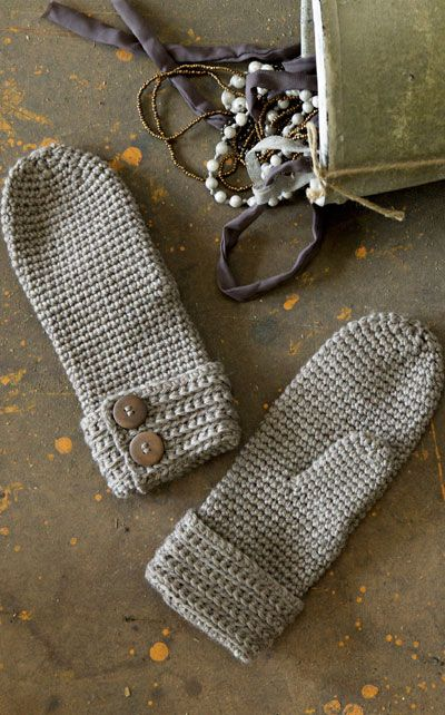 crochet mittens - the buttons give them just a bit of class!  Want to kick them up a notch to awesome gift status?  Add a soft, cotton flannel lining to them.  Oh yeah!