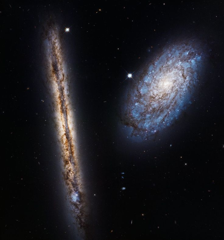 This stunning cosmic pairing of the two very different looking spiral galaxies NGC 4302 and NGC 4298 was imaged by the NASA/ESA Hubble Space Telescope. The image brilliantly captures their warm stellar glow and brown, mottled patterns of dust. As a perfect demonstration of Hubble's capabilities, this spectacular view has been released as part of the telescope's 27th anniversary celebrations.