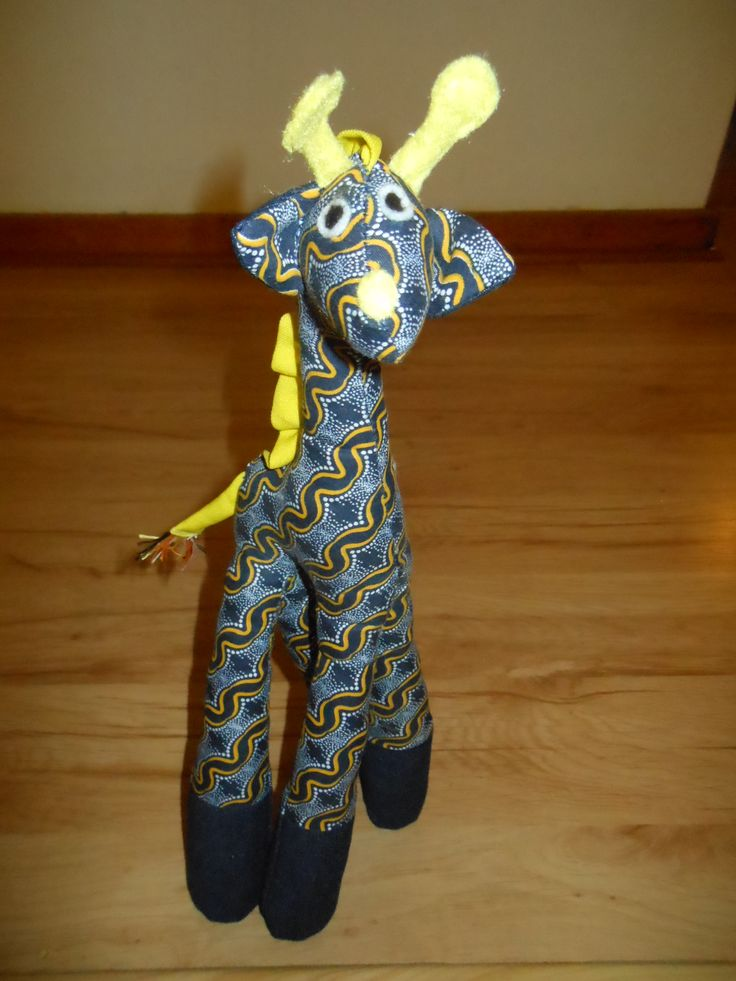 Georgie Giraffe looks quite different in his African print fabric.