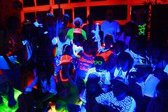 Highlighters are great because they glow in the dark under ultra violet lights. Giving your guests white t shirts or tank tops to draw on each other during the party is a great idea.    By asking each guest to wear neon colors in some way, from neon shoelaces to neon t shirts, they will glow in the dark. This should be an important rule.