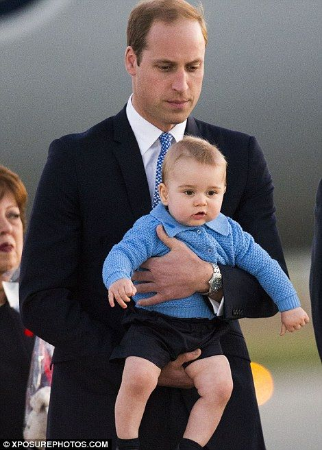Juggling parenthood: Kate passed baby George over to William and she carried a bunch of flowers, given to her by a girl at the airport.