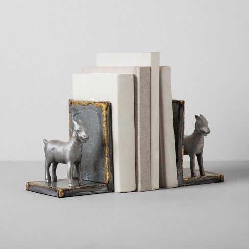 Give your bookshelf an instant style update with these Galvanized Goat Bookends from Hearth & Hand™ with Magnolia. These unique goat bookends feature a rustic welded finish around the edge that gives them a homey, handmade look — they pair a traditional style with a modern update that makes them perfect for any home. Even if you live in a big city, you can bring the warm touch of a farmhouse with these metal goat bookends. <br><br>Celebrate the everyday with...