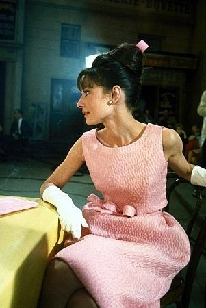 Audrey in a pink textural sheath with a slightly flared skirt & bow self-belt....so feminine & lovely.