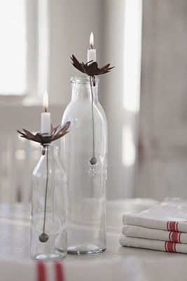 I've never seen candle holders like these. The weighty metal ball is placed inside a bottle with a chain it appears, and holds the base in position. Pretty cool! Question is where do I get them?