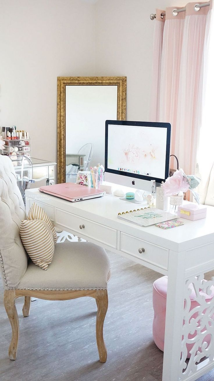 White cut-out desk with tufted office chair.