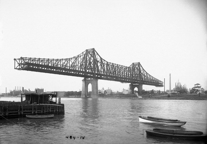 Queensboro Bridge under construction, on August 8, 1907. (Eugene de Salignac/Courtesy NYC Municipal Archives) #