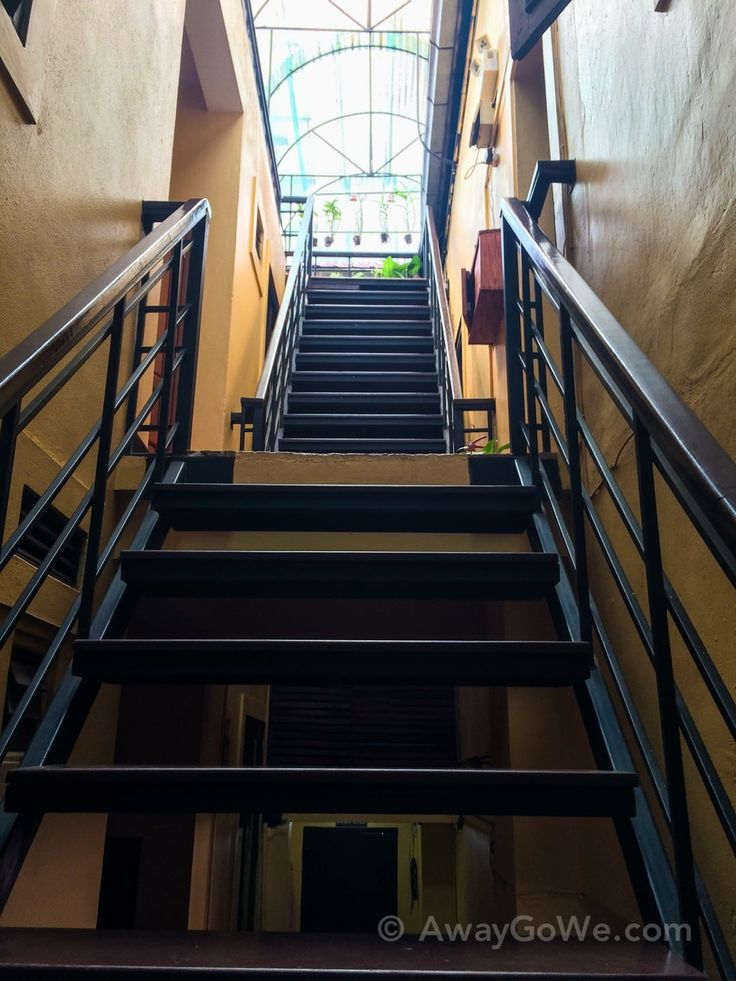 Steep stairs lead to clean and charming rooms in this beautiful colonial era hotel in the heart of Thakhek, Laos.
