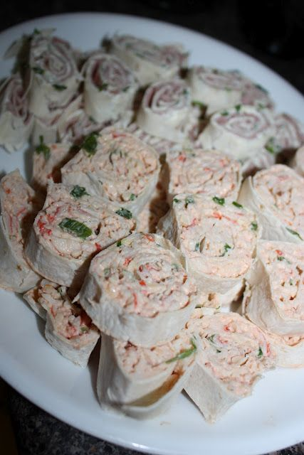 crab roll ups- tortilla, Neufchatel Cheese, cocktail sauce, crabmeat.  Make it lighter still with mix of reduced fat cream cheese and Greek yogurt.