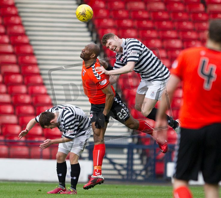 Queen's Park's Ryan McGeever wins the header during the SPFL League Two game between Queen's Park and Clyde.