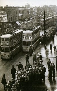 Tottenham High Road in the 1950's. A whole fleet of trolleybuses are pictured here ferrying the football crowd away from Spurs ground at nearby White Hart Lane.