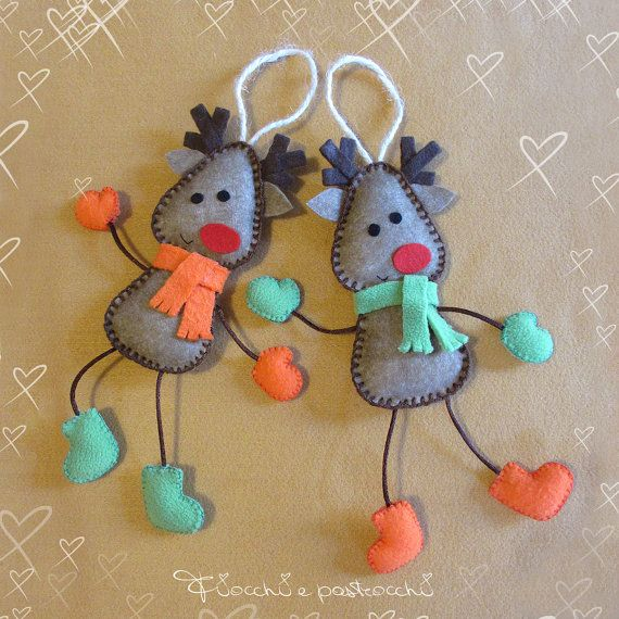 Rudolph the red-nosed reindeer made of felt. Very soft Christmas decorations with long legs, scarf, boots and gloves of fleece