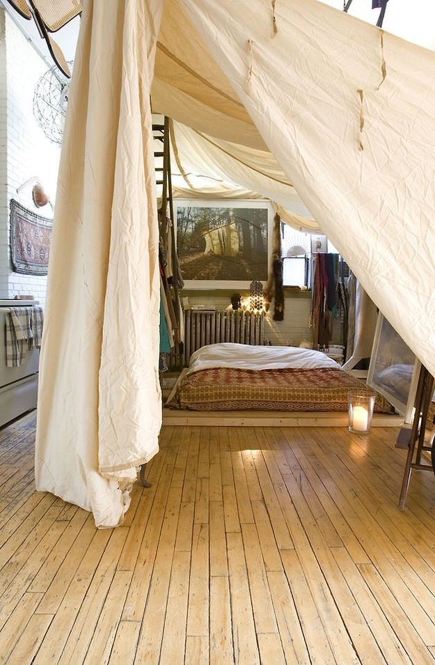 Put the bedroom under a gigantic canopy.  Hell.  And Yes.  A couple other cute ideas here as well.