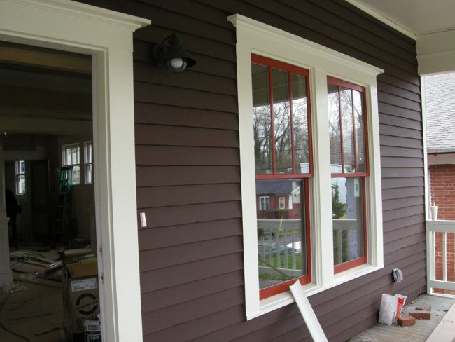 "cedar siding ""Turkish coffee"" brown, trim creamy white, windows ""Roycroft"" red."