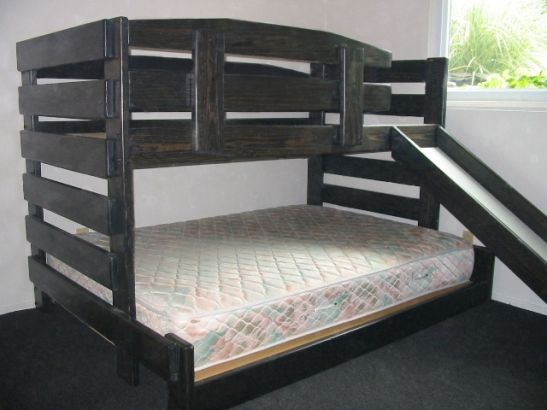 Kid-tough solid wood low bunk bed with slide. Available in various sizes. Custom built by hand. You choose the best finish and options for your room.