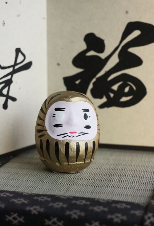 Japanese Daruma doll - Japanese traditional doll. The eyes of Daruma are often blank when its sold. The recipient of the doll fills in one eye upon setting the goal, then the other upon fulfilling it. In this way, every time they see the one-eyed Daruma, they recall the goal.