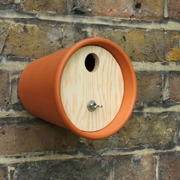 Bird sNest Box by designers Ed Ward and Carl Clerkin. A classic terracotta pot has been turned on its side with a douglas fir plywood entrance, adorned with a cute little wing nut perch.