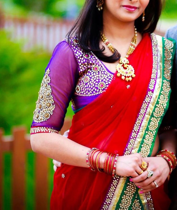 Here's what you can wear to an Indian wedding. Half saree with blouse and a statement necklace. Indian fashion.