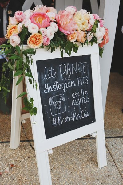 gorgeous signboard, love the floral on top + the instagram hashtag