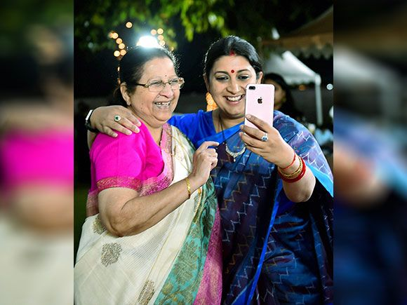 Union Minister for Textiles Smriti Irani take selfie with Lok Sabha Speaker Sumitra Mahajan during a cultural evening