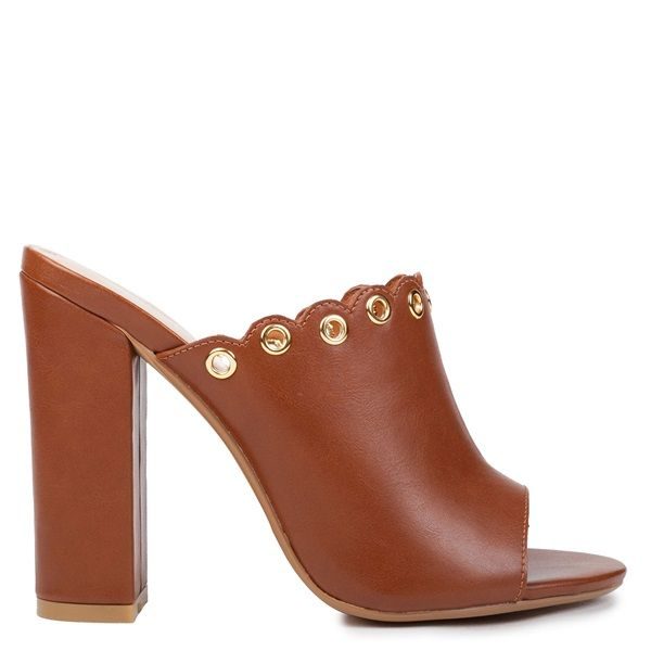Tobacco high heel mule sandal with block heel. Features crossed bands with metallic eyelets decoration.