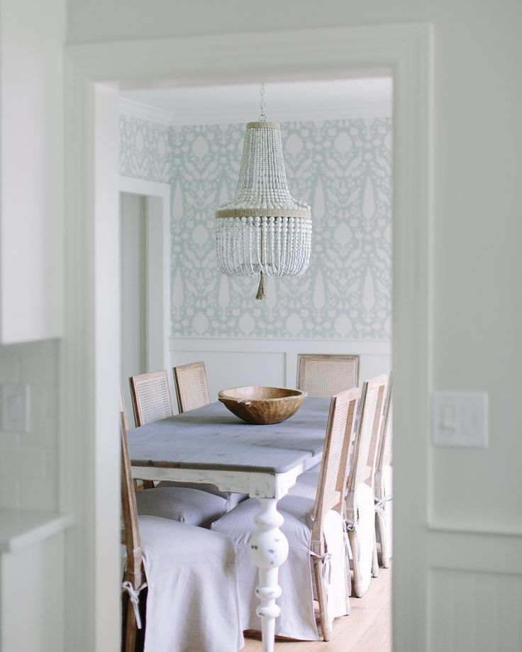 Coastal Farmhouse Dining Room With Wallpaper And White Beaded Chandelier