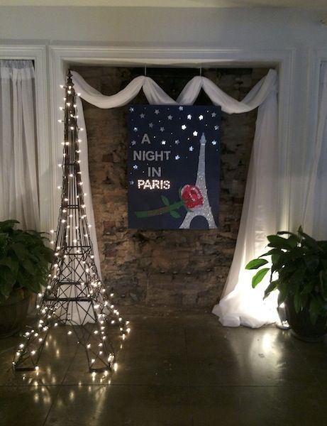 A night in paris theme? The hall and ballroom could all be lit up and have fabric draping from the walls/ceilings. Sara W