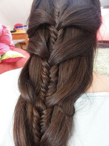 This is a beautiful mermaid braid made with large sections and a fishtail braid.
