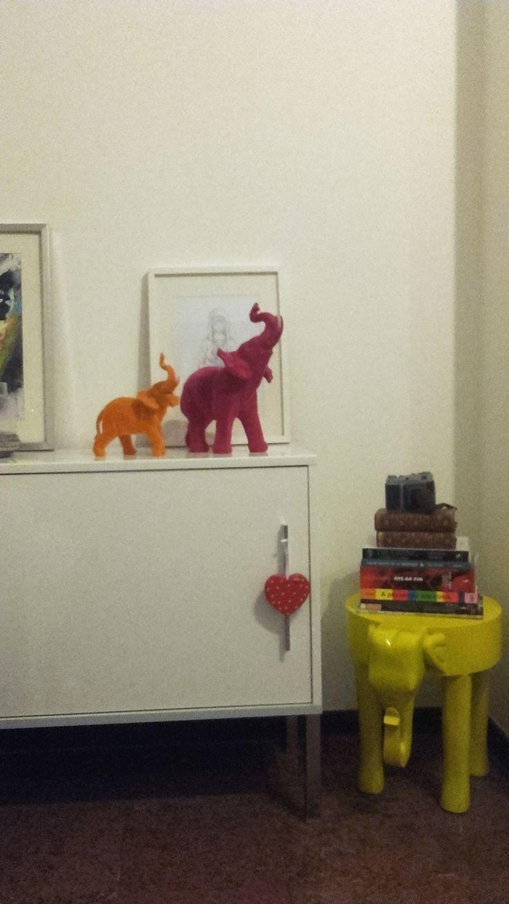 Elephants decor, living room and a pile of Books