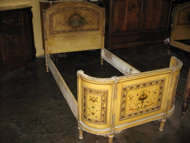 A Decorative pair of antique French painted twin beds. So adorable with fabulous hand painted detail and great colors! They are in good condition for their age with some wear and distress (they are very sturdy). Circa, 1890 Antiques.com $4800
