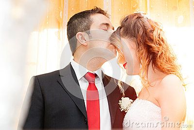 Husband kiss his wife on the forehead. romantic scene, the young couple…