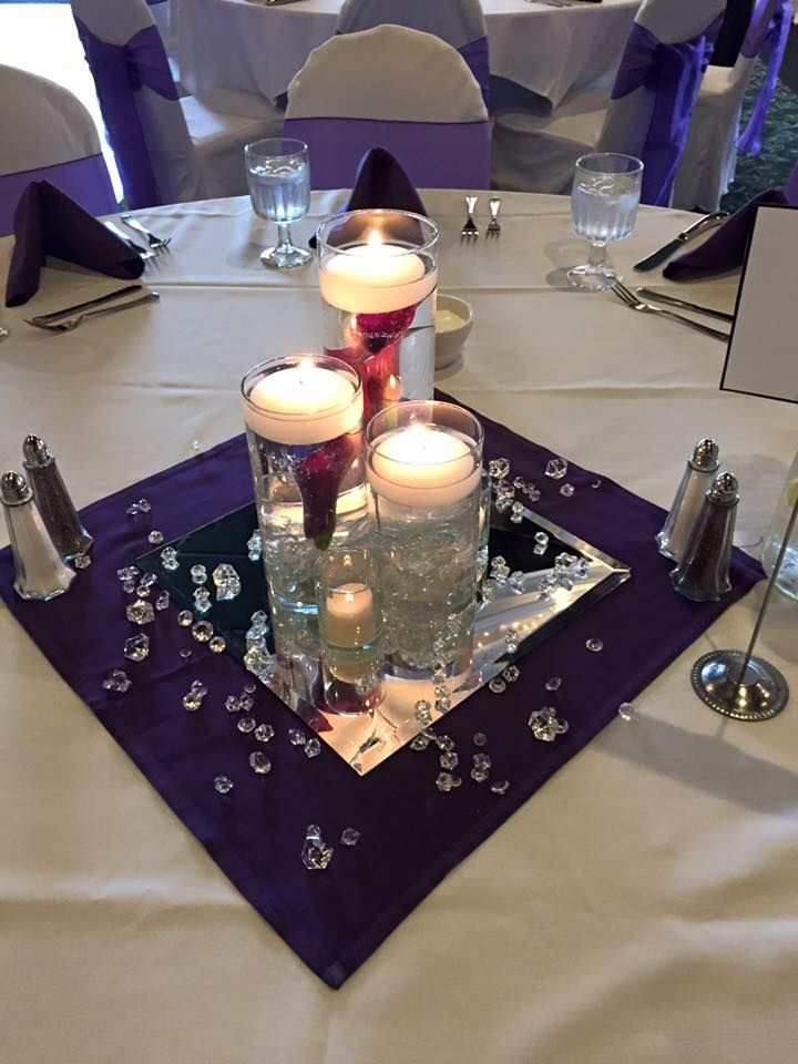 3 Tier Cylinder Vases With Submerged Purple Calla Lilies Surrounded By Bling And Votives