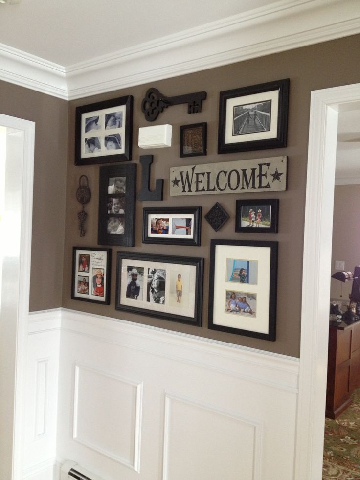 Picture collage for front entry and impressive wainscoting/crown moulding. Good paint scheme.