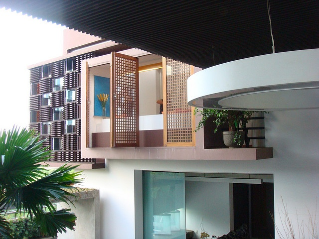 """""""This is the house of Ridwan Kamil, an Indonesian Architect. The house is framed with a brise-soleil made of thousands of redbull bottles."""" - daphne.ph"""