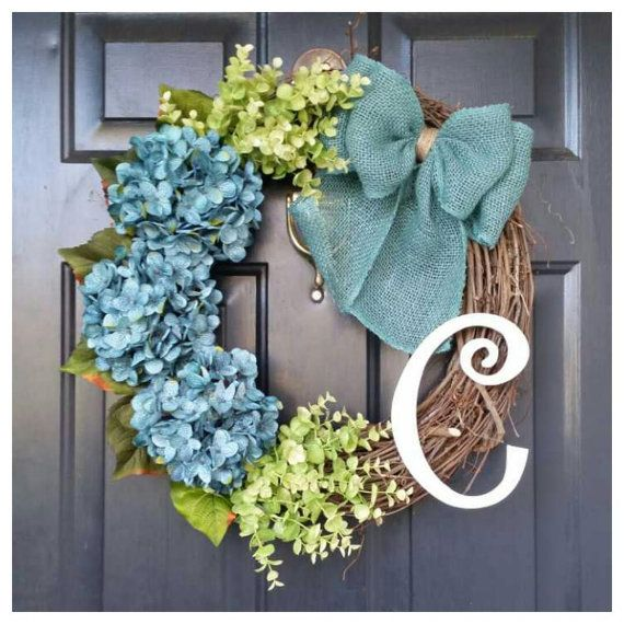 The Katelyn wreath will make a fantastic addition to your front door! It has 3 beautiful turquoise hydrangeas and pale green eucalyptus attached to a grapevine wreath and tied with a burlap turquoise bow. Pictured with a white monogram, choose the color and the initial monogram you would like to make it personal. Measures approximately 20 in diameter.  Each flower, bow and letter is glued and wired to the wreath for optimum durability