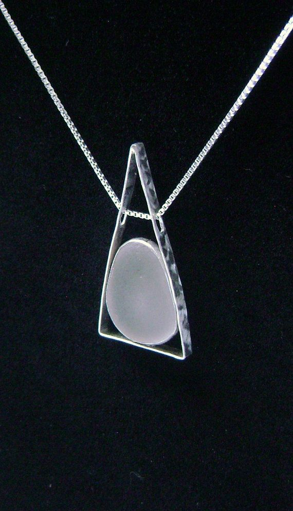 The white sea glass is genuine. It was found and supplied by.....https://www.etsy.com/shop/mamzelleseaglass and is no back bezel set. The pendant is handmade of 14 gauge round sterling wire that I forged flat and hand textured. It measures 7/8 x 1 7/8 inches. GN1101